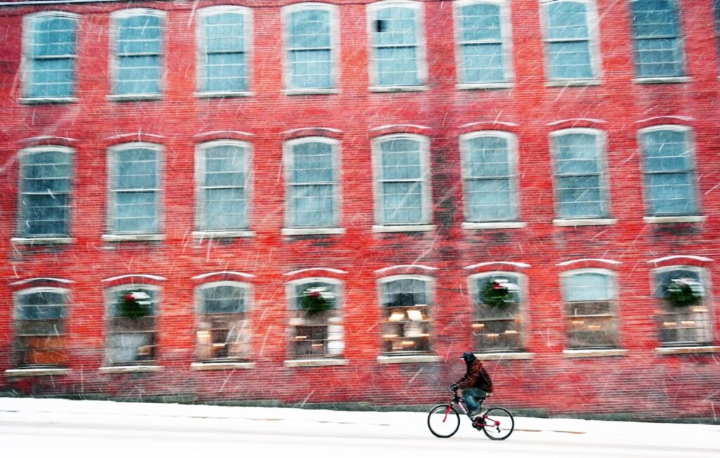A cyclist makes his way up Main Street in Biddeford during the storm Tuesday that dropped 2-6 inches across the region and made for very slick conditions.