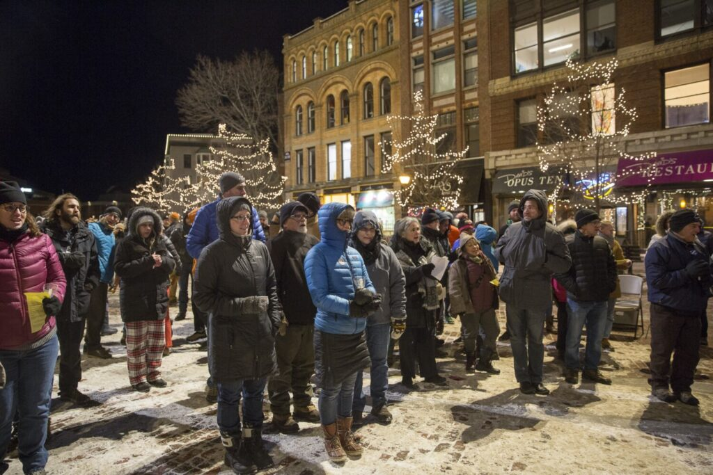 """People sang """"Amazing Grace"""" and other hymns at the end of Portland's annual vigil in Monument Square honoring the memory of homeless people who died this year."""