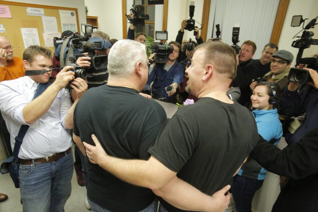 A crowd of photographers wait to take photos of Michael Snell, left, and Steven Bridges at Portland City Hall on Saturday, December 29, 2012, as they became the first same-sex couple to wed in Maine.