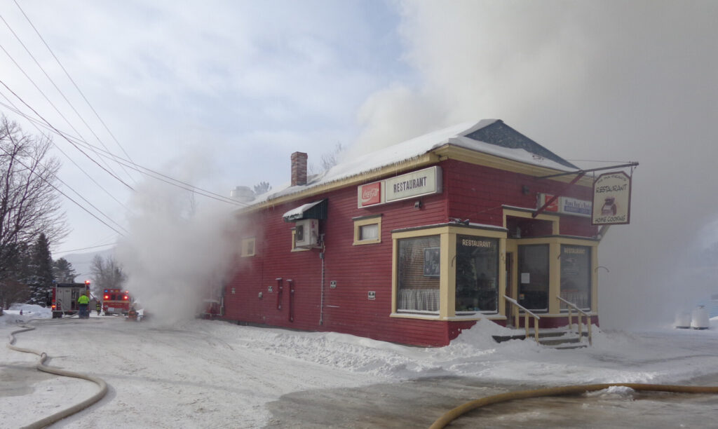 The wind Thursday made fighting a fire that destroyed a home in Jackman difficult. The tenant living in the home was working in the restaurant in front of the home, but discovered the fire too late. No damage was done to the restaurant.