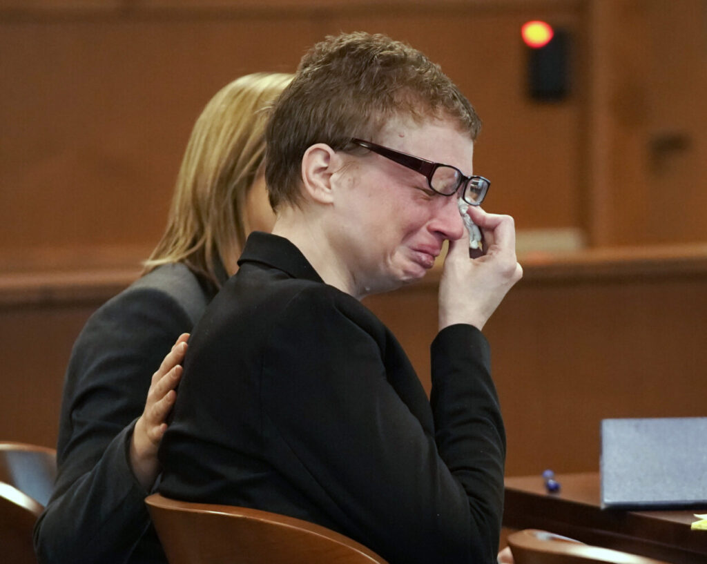Sharon Carrillo wipes tears from her eyes as her attorney Christopher MacLean delivers his opening statement to the jury Friday in Carrillo's trial in Waldo County Superior Court.