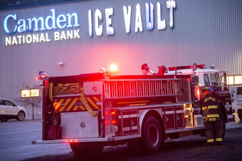 Firefighters evacuate the Camden National Bank Ice Vault at about 4 p.m. Saturday after a gas leak was detected prior to the start of a high school hockey game. About 100 people were evacuated.  Morning Sentinel photo by Michael G. Seamans