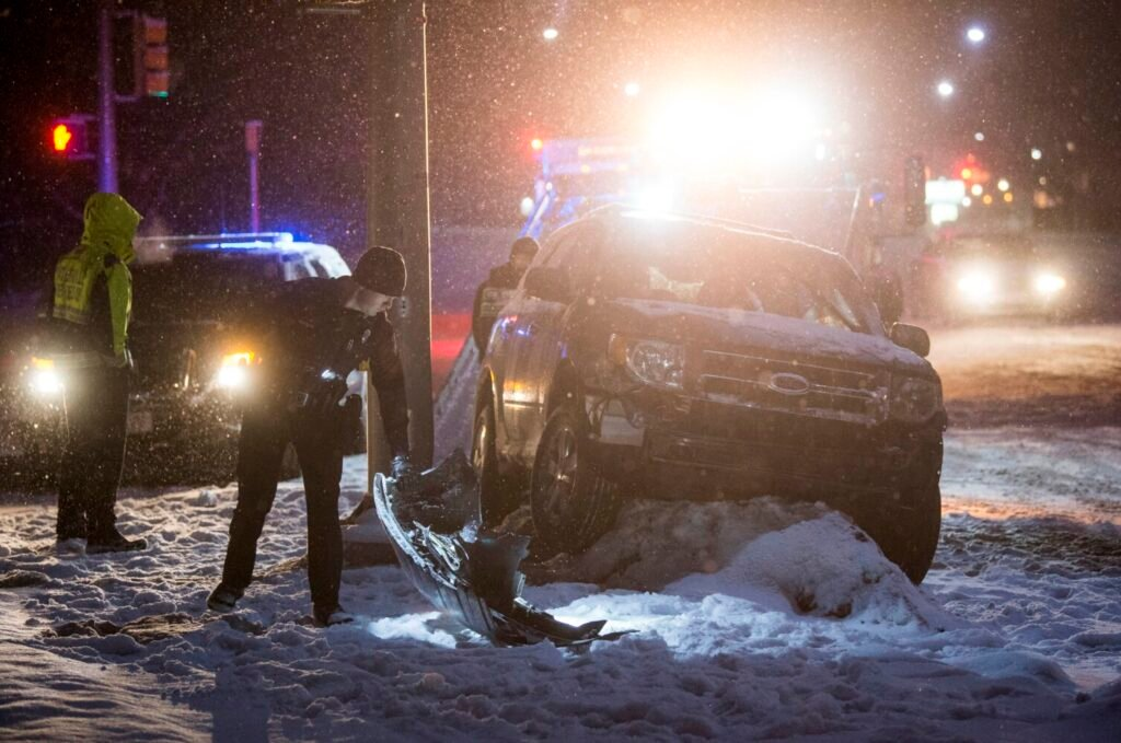 A late model SUV rests near a light pole at the intersection of Bridge Street and Water Street in Waterville on Tuesday. The vehicle struck another car on Main Street before hitting the pole on Bridge Street. According to police, alcohol is suspected as the cause.