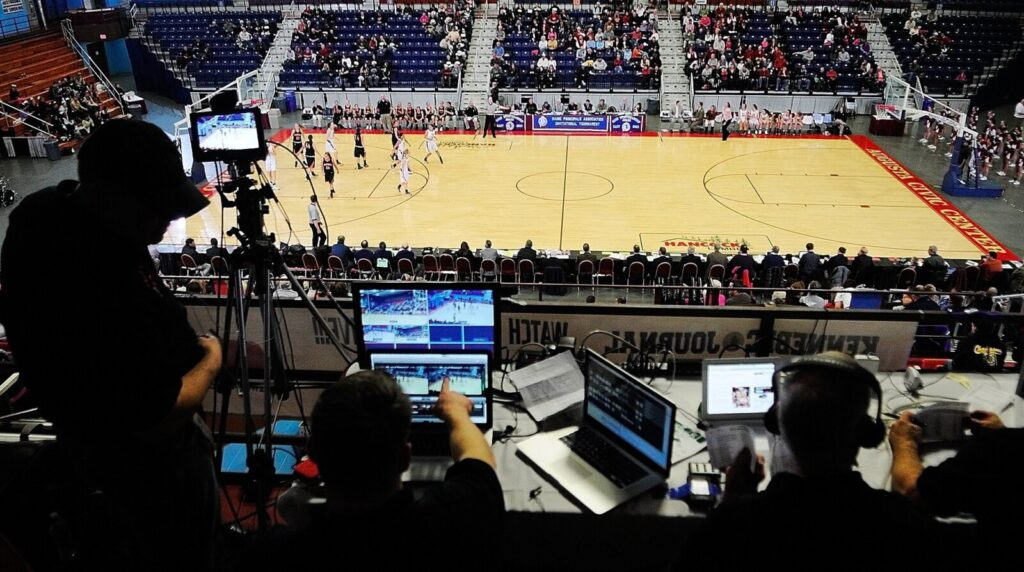 Working high above center court, the Munzing Media team covers an Eastern Class A tournament game between Skowhegan and Bangor on Feb. 15, 2013, at the Augusta Civic Center.