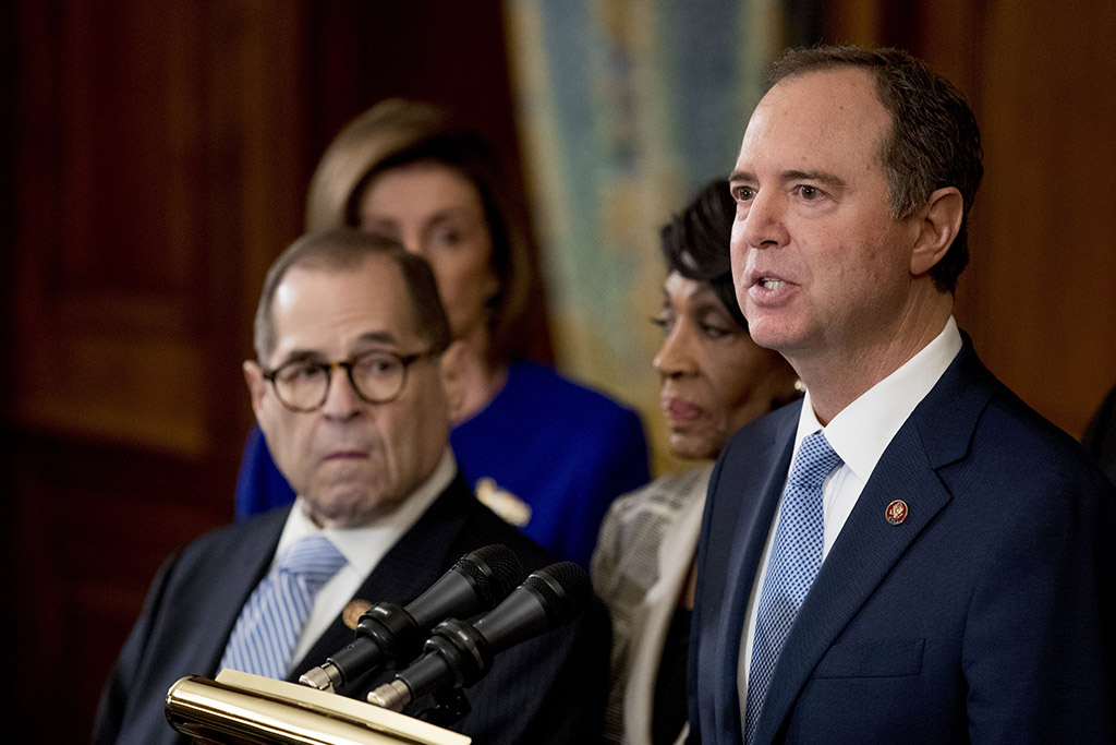 Rep. Adam Schiff, D-Calif., chairman of the House Intelligence Committee, speaks at a news conference Tuesday to announce articles of impeachment against President Trump, charging abuse of power and obstruction of Congress.