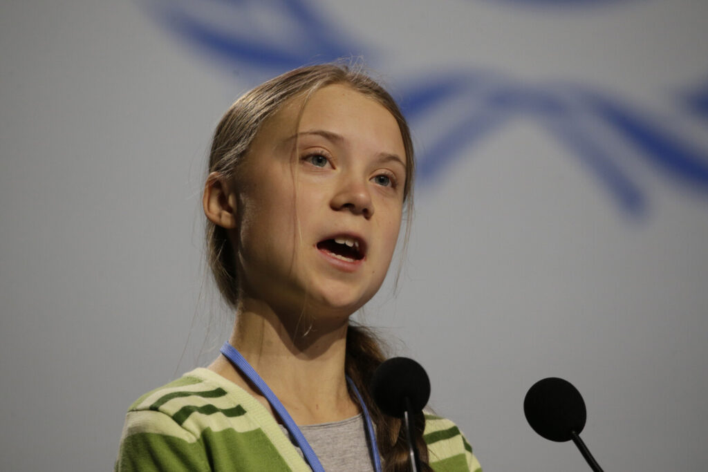 Swedish climate activist Greta Thunberg addresses plenary of U.N. climate conference during with a meeting with leading climate scientists at the COP25 summit in Madrid, Spain, Wednesday, Dec. 11. Thunberg is in Madrid where a global U.N.-sponsored climate change conference is taking place.