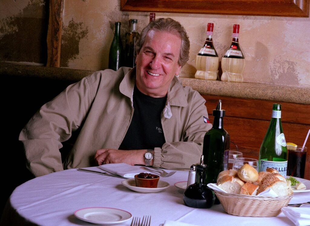 """In this July 28, 2001 file photo, Danny Aiello poses for a photo at Gigino restaurant in New York. Aiello, the blue-collar character actor whose long career playing tough guys included roles in """"Fort Apache, the Bronx,""""  """"The Godfather, Part II,"""" """"Once Upon a Time in America"""" and his Oscar-nominated performance as a pizza man in Spike Lee's """"Do the Right Thing,"""" has died."""