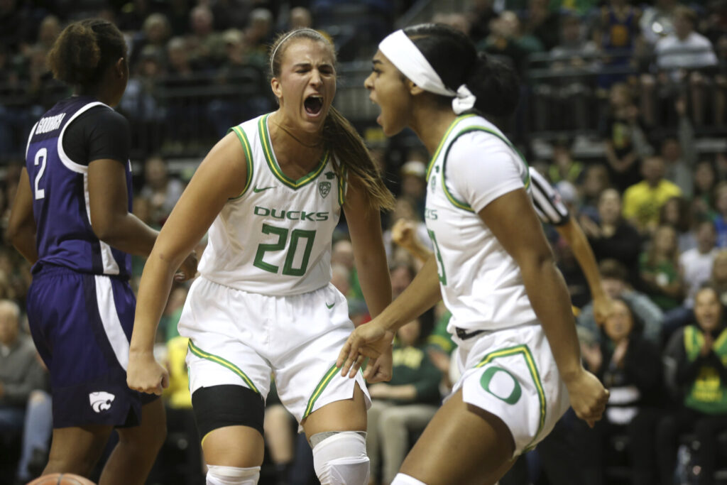 Oregon's Sabrina Ionescu, center, and Minyon Moore celebrate during the Ducks' 89-51 win over Kansas State on Saturday in Eugene, Oregon.