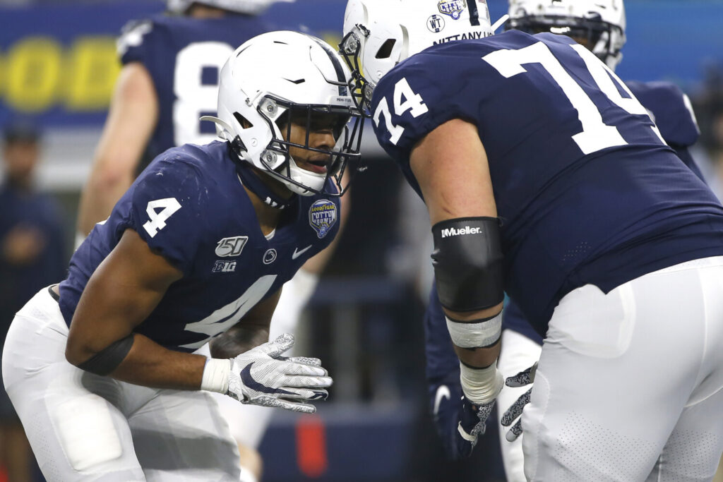 Penn State running back Journey Brown, left, and teammate  Steven Gonzalez celebrate after Brown scored a touchdown against Memphis in the first half of the Cotton Bowl on Saturday in Arlington, Texas.