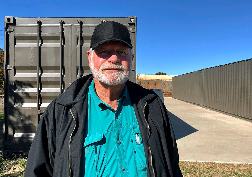 Jack Wilson, 71, poses at the firing range outside his home in Granbury, Texas, on Monday. Wilson trains the volunteer security team of the West Freeway Church of Christ, where a gunman shot two people Sunday before being shot by Wilson.