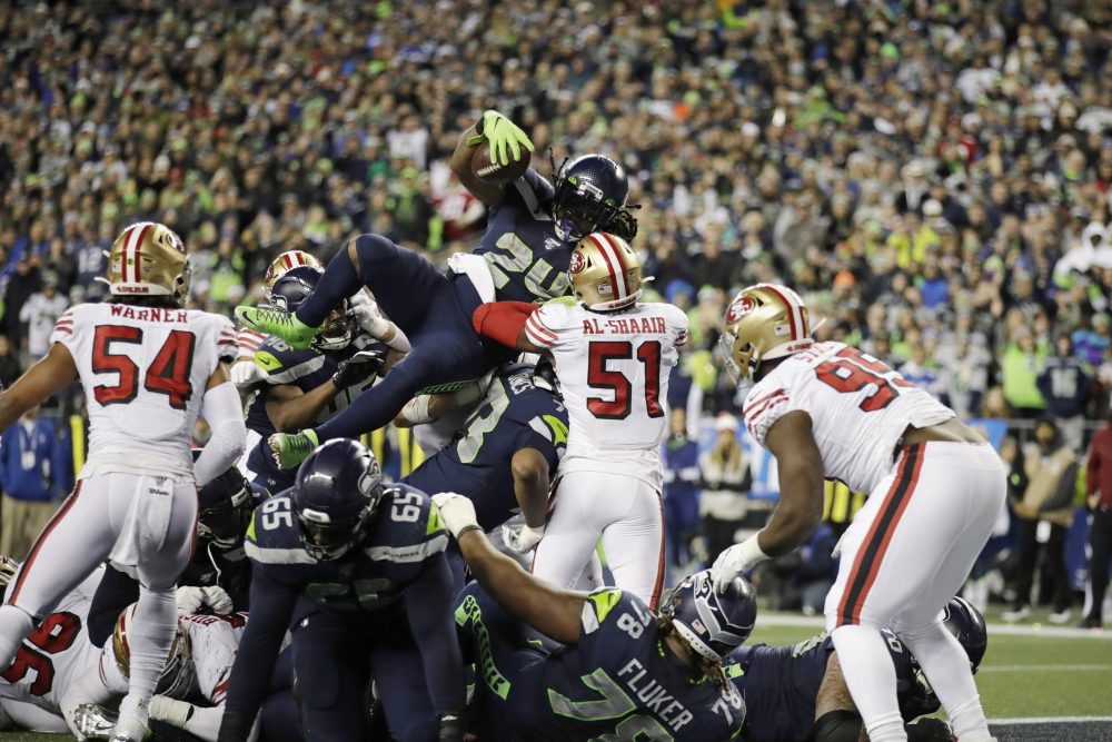 Seattle's Marshawn Lynch scores a touchdown on a 1-yard rush against the San Francisco 49ers during the second half Sunday night in Seattle. The 49ers defense held late to win the game and the division.