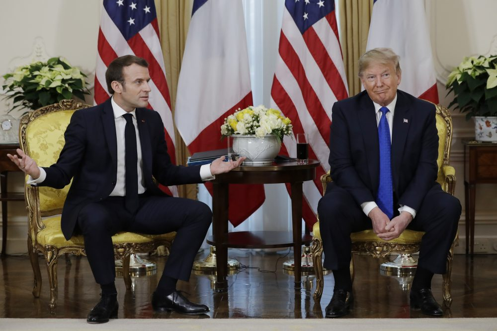 President Trump meets French President Emmanuel Macron at Winfield House on Tuesday in London. The French government fired back against the Trump administration, insisting the European Union would retaliate if the White House went through with its tariff proposal.