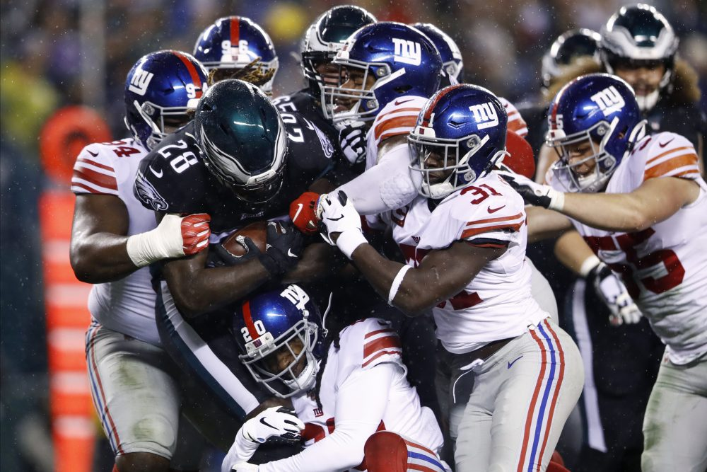 Philadelphia's Jay Ajayi (28) is tackled by the New York Giants.