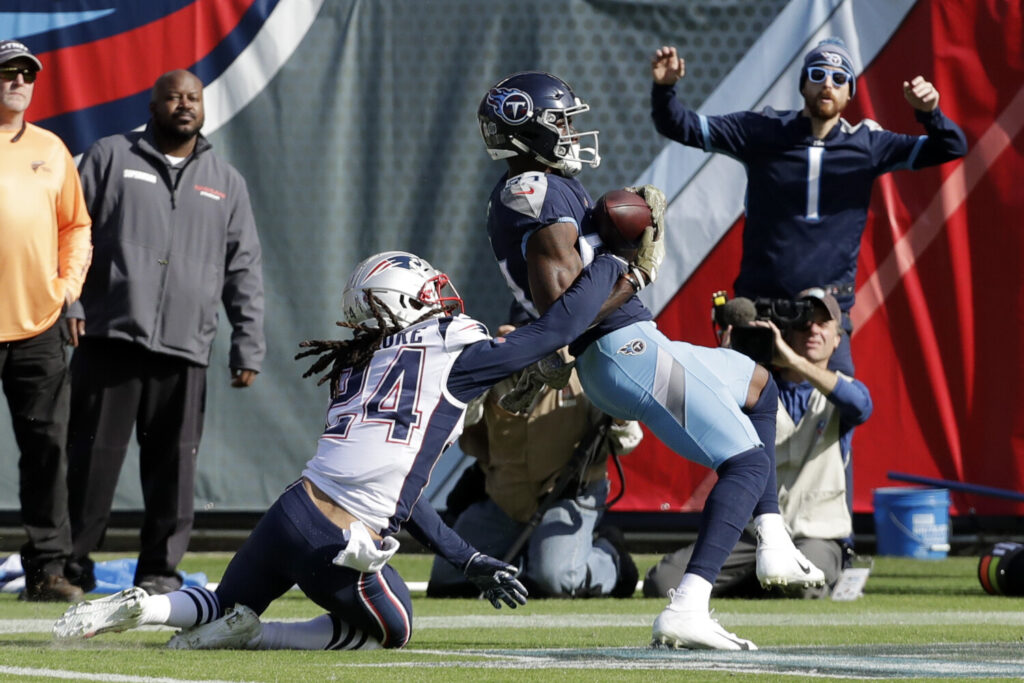 Stephon Gilmore, left, and the Patriots face Corey Davis and the Titans in the first-round of the playoffs on Saturday. The Titans beat the Patriots last season. They have lost to the Chiefs and the Ravens, also possible playoff opponents, this season.