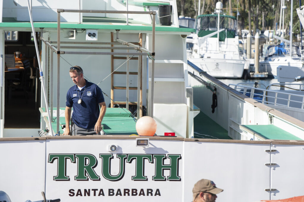 FBI agents search the Truth dive boat, a sister vessel to the Conception, as authorities issue a search warrant for the Truth Aquatics' offices on the Santa Barbara Harbor in Santa Barbara, Calif., in September. Thirty-four people died when the Conception burned and sank before dawn on Sept. 2. They were sleeping in a cramped bunk room below the main deck and their escape routes were blocked by fire.