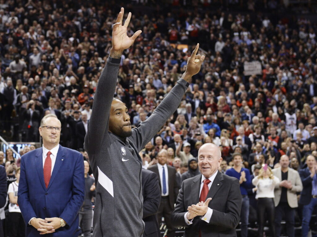 Kawhi Leonard, the former Toronto Raptor now with the Los Angeles Clippers, forward  salutes the crowd as he receives his 2019 NBA championship ring prior to Wednesday's game in Toronto.