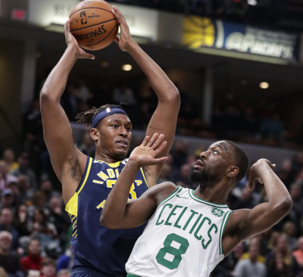 Indiana's Myles Turner grabs a rebound over Boston's Kemba Walker during Wednesday's game in Indianapolis.