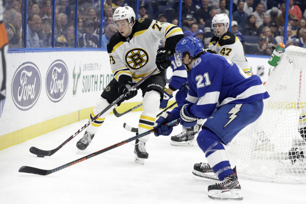 """Boston  defenseman Charlie McAvoy, left, said the Bruins are not pinicking despite a five-game losing streak. """"I think we know the kind of team we are in here, we know we're a special group. These things happen."""""""