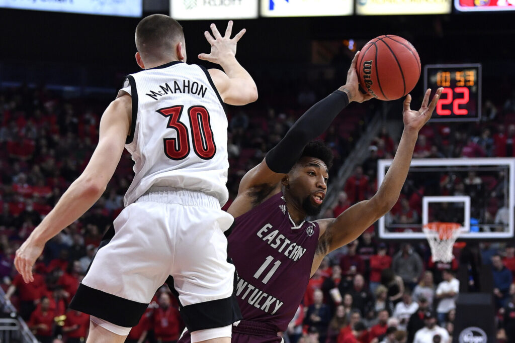 Eastern Kentucky guard Jomaru Brown tries to make a pass while being guarded by Louisville's Ryan McMahon during the Cardinals' 99-67 win Saturday in Louisville, Kentucky.