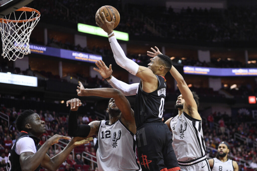 Russell Westbrook scored 31 points and the Houston Rockets rallied from 25 points down to beat the San Antonio Spurs 109-107 on Monday in Houston.