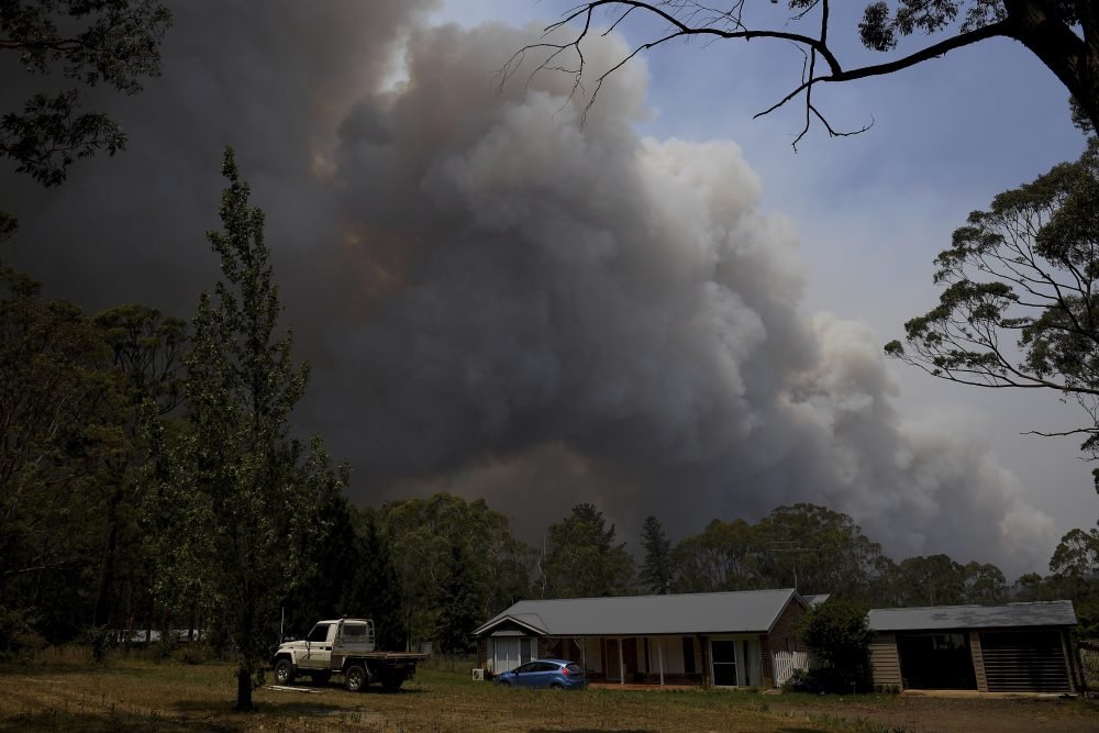 Smoke from the Grose Valley fire rises in the distance in Sydney on Saturday.