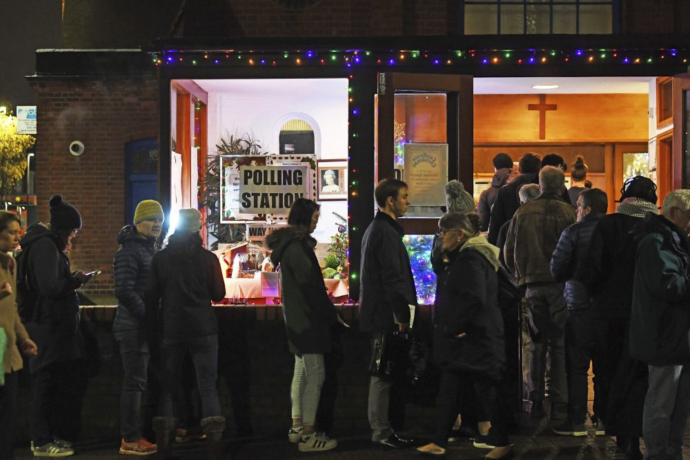 Voters queue outside St. Andrews Church polling station in Balham, south London, just hours before voting closes for the general election on Thursday.