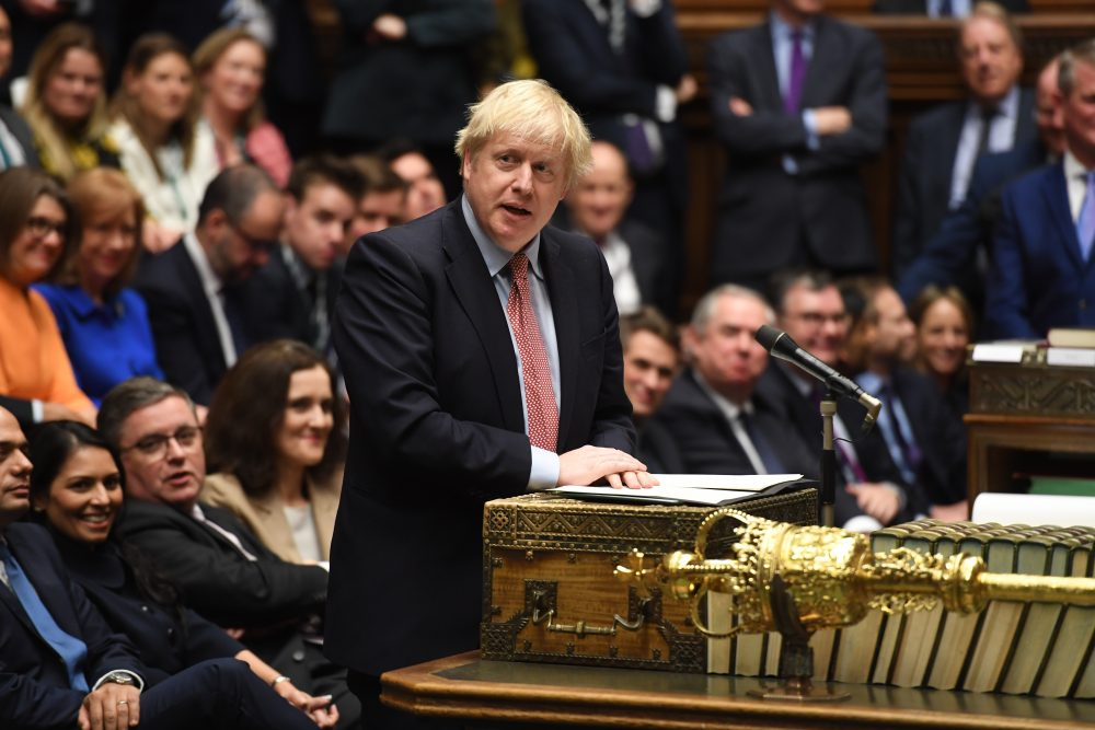 In this photo released by the House of Commons, Britain's Prime Minister Boris Johnson speaks to the house on the first day of the new Parliament, in London, Tuesday, Dec. 17, 2019. Buoyed by a big new Conservative majority in Parliament, Johnson toughened his Brexit stance on Tuesday, ruling out any extension of an end-of-2020 deadline to strike a trade deal with the European Union. (Jessica Taylor/House of Commons via AP)