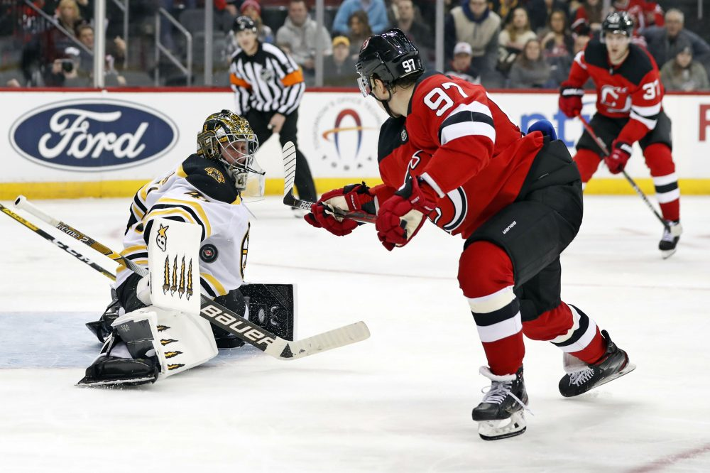 Boston Bruins goaltender Jaroslav Halak blocks a shot by New Jersey Devils left wing Nikita Gusev during the Devils' 3-2 win in a shootout on Tuesday in Newark, N.J.