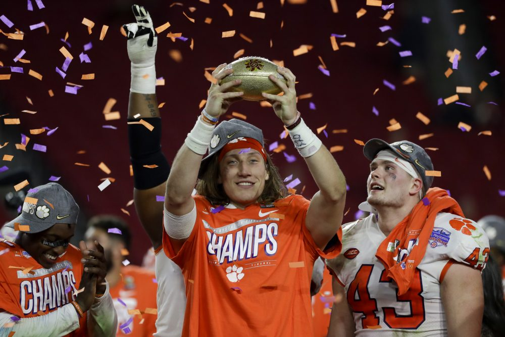 Clemson quarterback Trevor Lawrence holds up the trophy after Clemson's 29-23 win over Ohio State in the Fiesta Bowl on Saturday in Glendale, Ariz. The Tigers are playing in their fourth title game in five years and haven't lost in nearly two years.