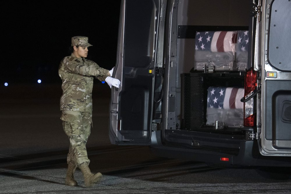 Air Force Door Attendant Staff Sgt. Siannie Conception closes the door of the transfer vehicle carrying the transfer cases containing the remains of Ensign Cameron Joshua Kaleb Watson, Seaman Mohammed Sameh Haitham and Seaman Apprentice Cameron Scott Walters, Sunday, Dec. 8, 2019, at Dover Air Force Base, Del. A Saudi gunman killed the three in a shooting at Naval Air Station Pensacola in Florida.