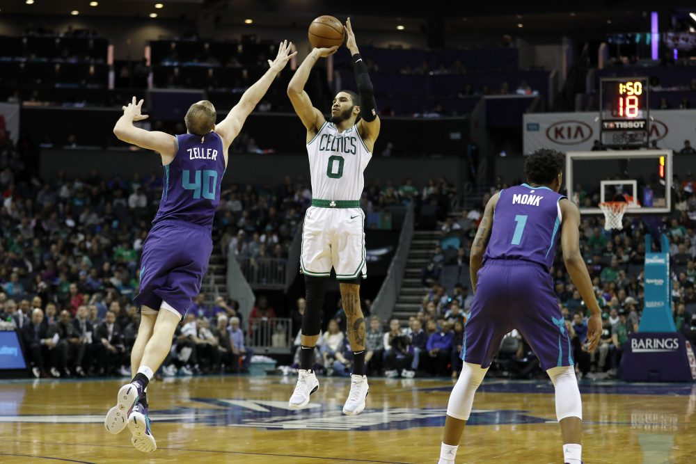 Boston's Jayson Tatum takes a 3-pointer with Charlotte's Cody Zeller defending. Tatum scored 24 points and Boston earned a 109-92 win Tuesday in Charlotte, North Carolina.