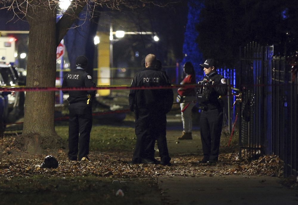 Chicago police guard a crime scene in the 5700 block of South May Street after a shooting Sunday.