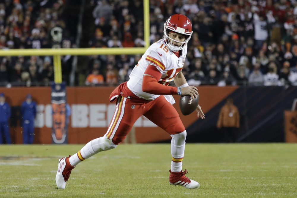 Kansas City quarterback Patrick Mahomes runs for a 12-yard touchdown against the Bears in the first half.