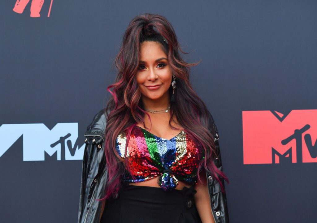 "Reality TV personality Nicole ""Snooki"" Polizzi arrives at the 2019 MTV Video Music Awards on Aug. 26. The ""Jersey Shore"" star says she's quitting the show."