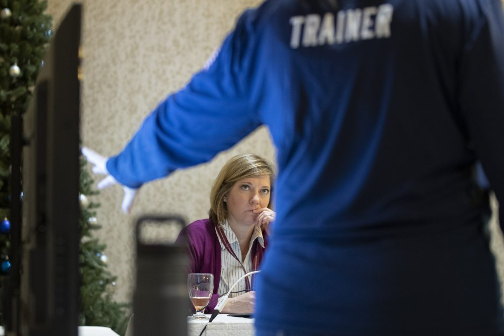 Karen Brenson Bell, of North Carolina, listens during an exercise run by military and national security officials for state and local election officials to simulate different scenarios for the 2020 elections, in Springfield, Va., this month.