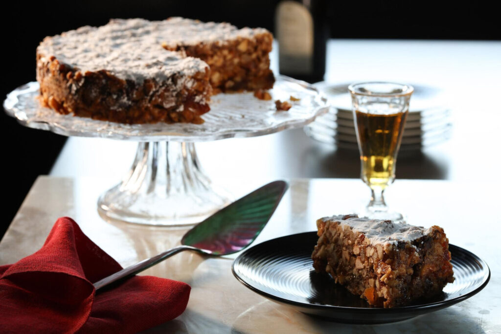 Panforte is a traditional Italian sweet, said to be invented in Siena, filled with nuts, dried fruits and spices. A glass of vin santo (which means holy wine) makes a beautiful companion.