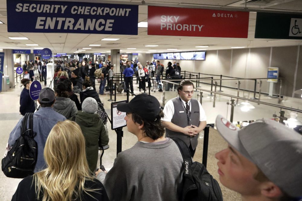 Travelers walk through a security checkpoint in Terminal 2 at Salt Lake City International Airport on Nov. 27. Federal officials are considering requiring that all travelers, including American citizens, be photographed as they enter or leave the country as part of an identification system using facial-recognition technology.