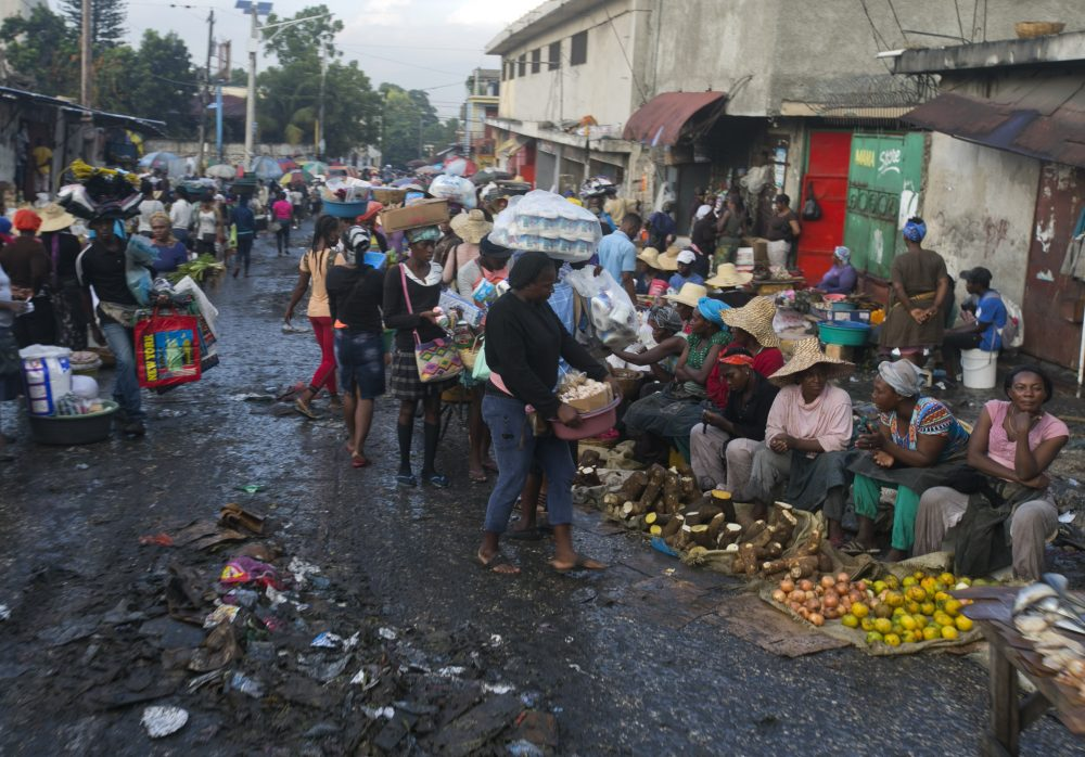 Street vendors sell their produce in Petion-Ville, Haiti, on Dec. 4. A growing number of families across Haiti can't afford to buy food since protests began in September, with barricades preventing the flow of goods between the capital and the rest of the country.