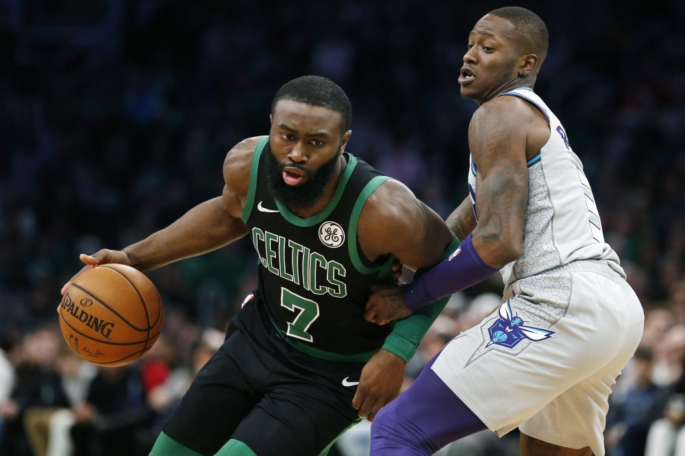 Jaylen Brown, left, was sick Monday and unable to practice with the Celtics. He will miss their game Tuesday against Charlotte.