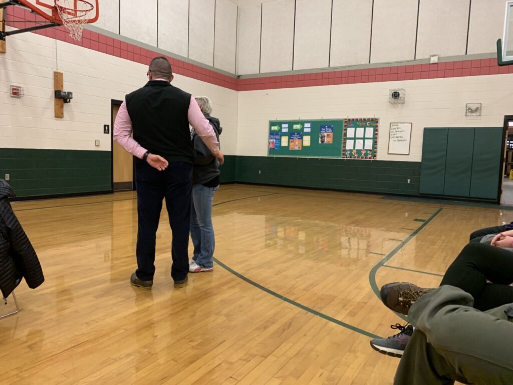 Local resident Leah May is removed from the gymnasium at Carrabec Community School during Regional School Unit 74 board meeting Wednesday night. May shouted at board members during a heated exchange about an investigation regarding a teacher who was recently placed on administrative leave.