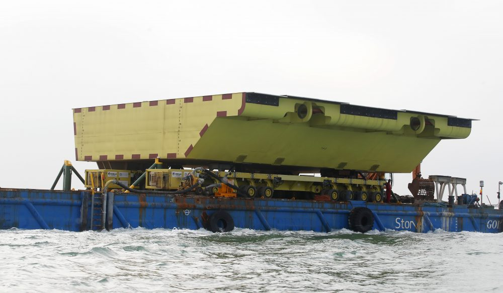 A yellow barrier, part of a plan to protect the city of Venice from flooding, floats on a barge. Central to the plan to protect Venice, some, or all, of the 78 barriers will one day be raised when the sea rises more than 110 centimeters to prevent damaging high tides from pushing into the lagoon city.