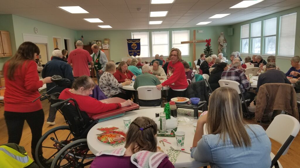 The Knights of Columbus Council 2392 held a festive event for the older citizens of the Moose River Valley with their December luncheon. In attendance were 48 people who enjoyed a ham dinner, a visit from Santa, festive music and lots of gifts.