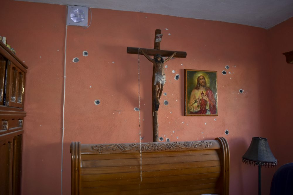 A wall of the room of a home is riddled with bullet holes after a gun battle between Mexican security forces and suspected cartel gunmen Saturday in Villa Union, Mexico.