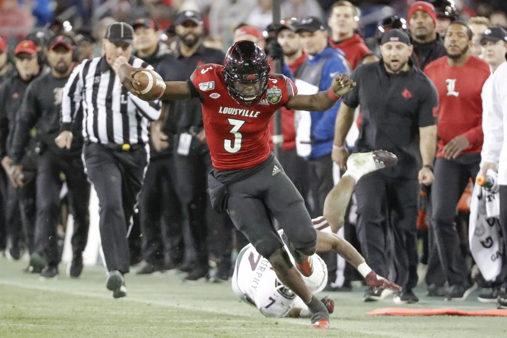 Louisville quarterback Micale Cunningham tries to stay in bounds as he carries the ball during the Cardinals' 38-28 win over Mississippi State in the Music City Bowl on Monday.