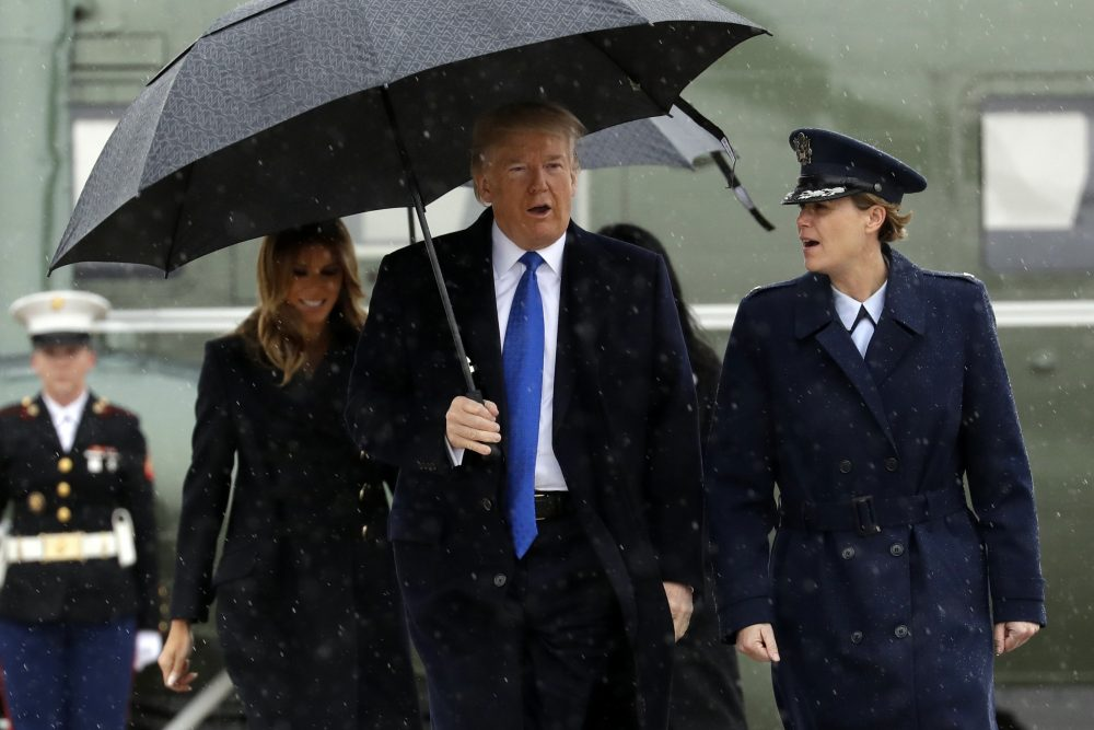 President Trump and first lady Melania Trump walk to board Air Force One for a trip to London to attend the NATO summit on Monday at Andrews Air Force Base, Md.