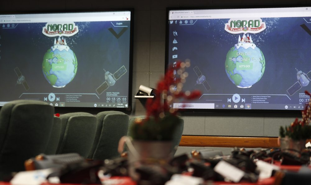 Monitors are illuminated in the NORAD Tracks Santa center at Peterson Air Force Base, Monday, Dec. 23, 2019, in Colorado Springs, Colo.