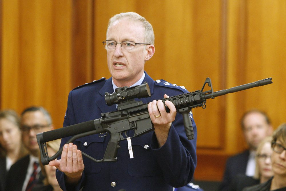 Acting police superintendent Mike McIlraith shows New Zealand lawmakers an AR-15 style rifle similar to one of the weapons a gunman used to slaughter 51 worshippers at two Christchurch mosques, in Wellington this year.
