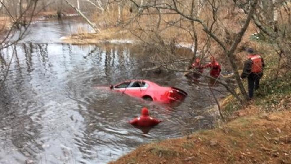 Divers search Moose Pond Brook in West Paris after a car went off Route 26 on Friday morning, killing the driver.