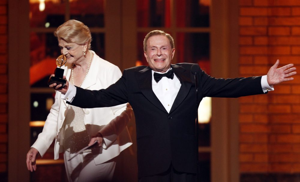 In this June 7, 2009, file photo, Jerry Herman accepts his Special Tony Award for Lifetime Achievement in the Theater from Angela Lansbury at the 63rd Annual Tony Awards in New York.