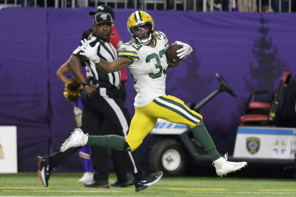 Green Bay running back Aaron Jones finishes a 56-yard touchdown in the second half.